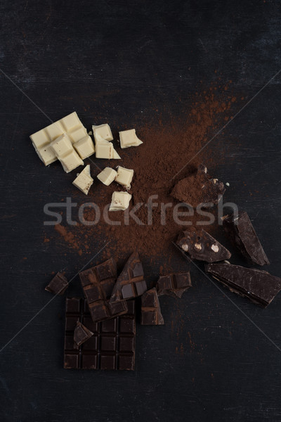 Top view of a chocolate bar crashed in pieces Stock photo © deandrobot