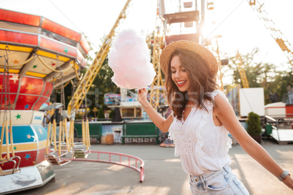 Happy smiling girl with cotton candy having fun Stock photo © deandrobot