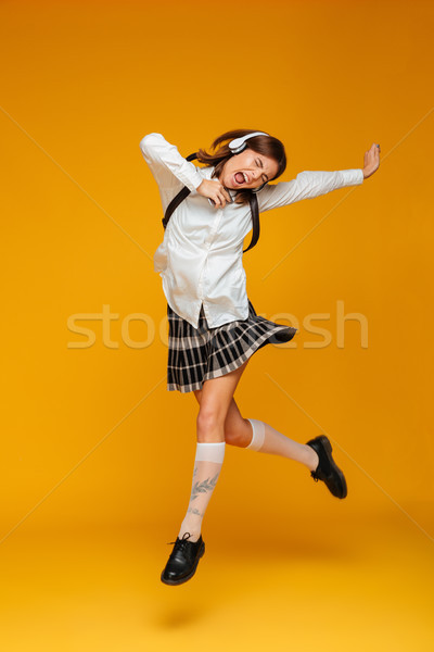 Retrato excitado colegiala uniforme Foto stock © deandrobot