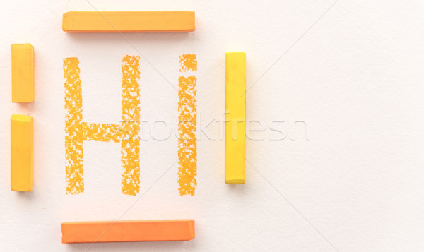 Top view of word Hi drawn with orange pastel chalk Stock photo © deandrobot