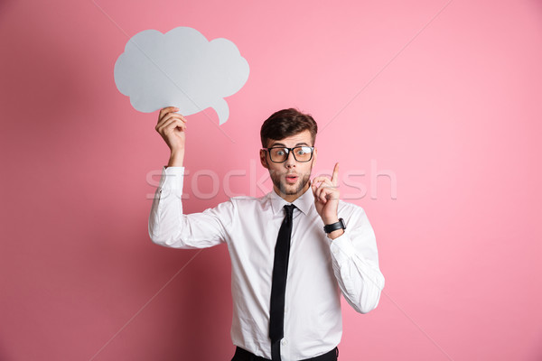 Portrait of an excited smart man in white shirt Stock photo © deandrobot