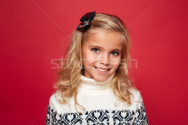 Portrait of a cute little girl in christmas sweater Stock photo © deandrobot