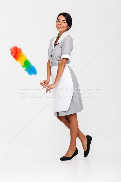 Foto aantrekkelijk huishoudster poseren kleurrijk Stockfoto © deandrobot