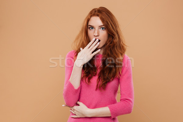 Close up portrait of an astonished young redhead girl Stock photo © deandrobot
