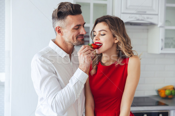 Portrait of a young romantic smart dressed couple Stock photo © deandrobot