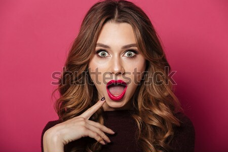Portrait of a confused brown haired woman Stock photo © deandrobot
