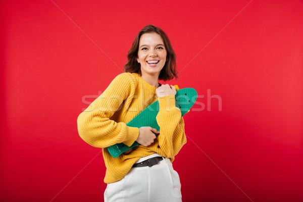 Portrait fille heureuse skateboard regarder caméra Photo stock © deandrobot