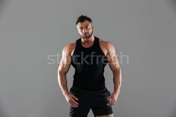 Portrait of a confident serious male bodybuilder Stock photo © deandrobot