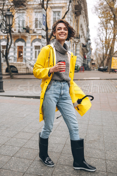 Alegre bastante mulher jovem foto amarelo Foto stock © deandrobot