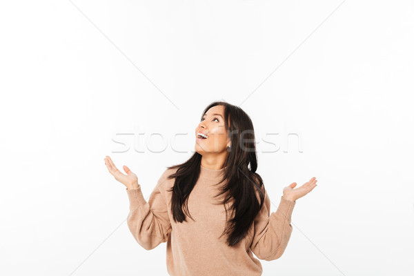Asian excited surprised lady looking aside. Stock photo © deandrobot