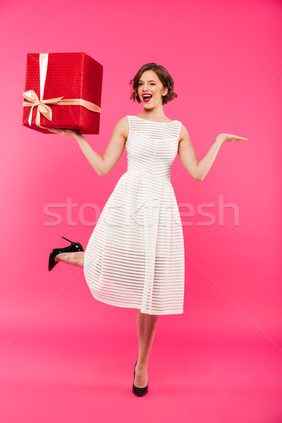 Full length portrait of a cheery girl Stock photo © deandrobot