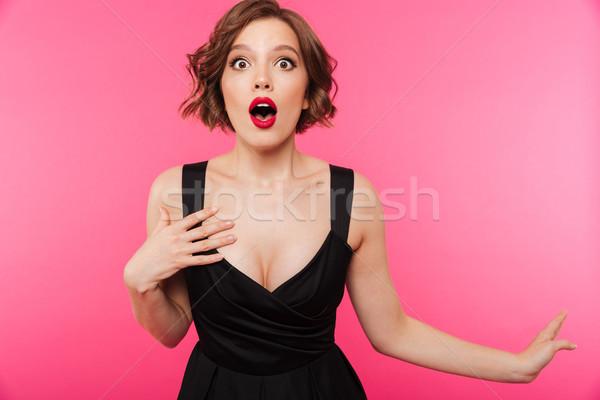 Portret dziewczyna czarna sukienka stwarzające stałego Zdjęcia stock © deandrobot