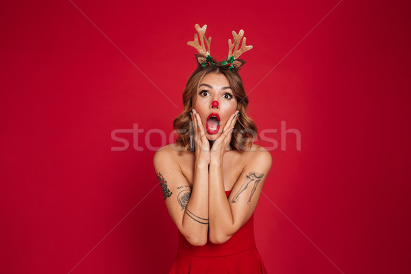 Portrait of a shocked surprised girl wearing christmas deer costume Stock photo © deandrobot