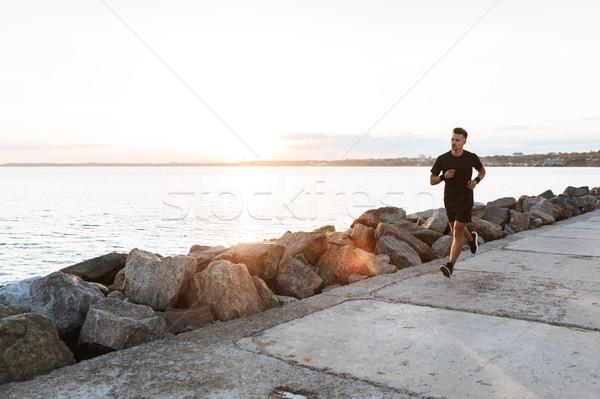 Portret zagęszczony sportowiec jogging plaży morza Zdjęcia stock © deandrobot