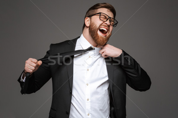 Portrait of an angry young businessman Stock photo © deandrobot