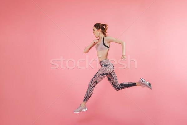 Grave concentrado jóvenes fitness deportes mujer Foto stock © deandrobot