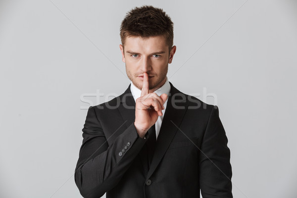 Portrait of a confident young businessman Stock photo © deandrobot