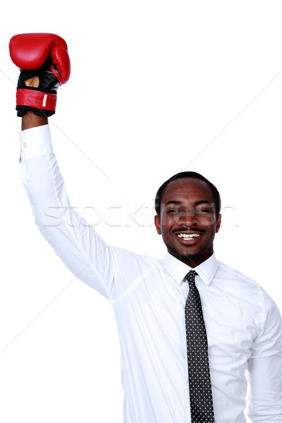 Businessman with boxing gloves raised his hand over white background Stock photo © deandrobot