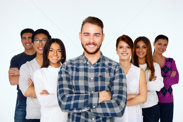 Portrait of happy young casual people with arms folded over white background Stock photo © deandrobot
