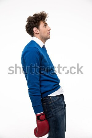 Portrait of a defeated young man over white background Stock photo © deandrobot