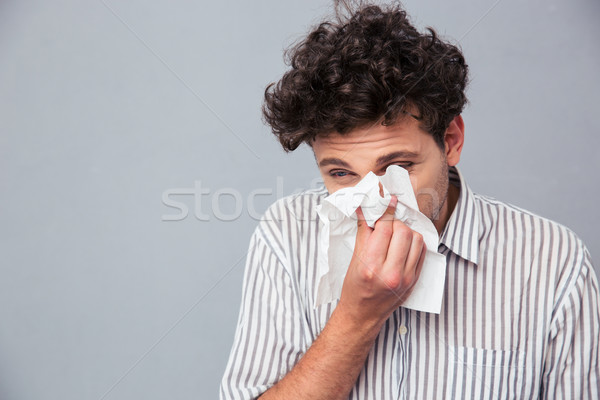 Man blowing his nose Stock photo © deandrobot