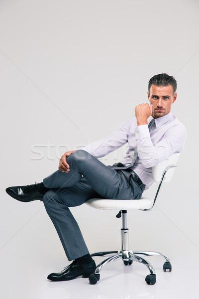 красивый бизнесмен сидят офисные кресла портрет изолированный Сток-фото © deandrobot