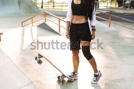 Full length portrait of a serious female tennis player Stock photo © deandrobot