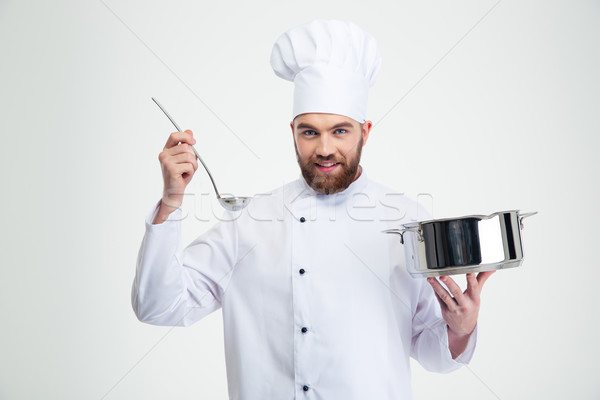 Male chef cook holding a saucepan and ladle Stock photo © deandrobot
