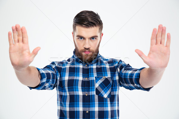 Man showing stop gesture with palms Stock photo © deandrobot