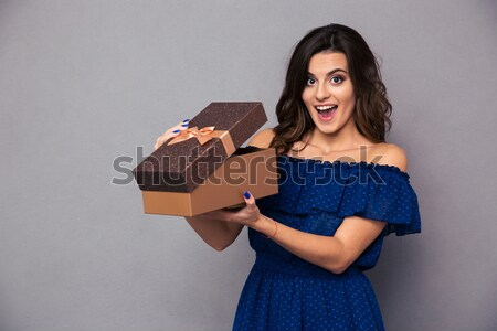 Happy woman opening gift box Stock photo © deandrobot