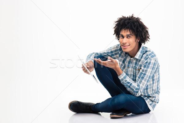 Afro amerikai férfi tart táblagép portré Stock fotó © deandrobot