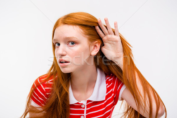 Curious young female trying to listen rumors Stock photo © deandrobot