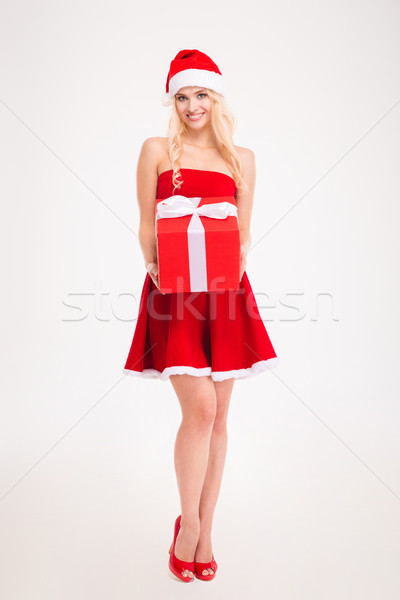 Seductive young woman in red santa claus dress and hat Stock photo © deandrobot