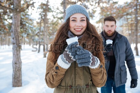 Couple drinking coffee in winter park Stock photo © deandrobot