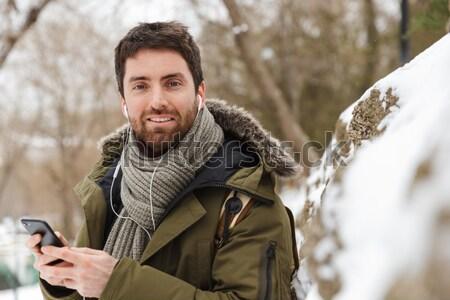 Man standing outdoors in winter Stock photo © deandrobot