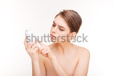 Femme lecture chimiques pilules jeune femme isolé Photo stock © deandrobot