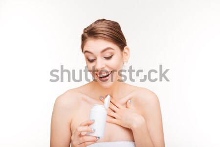 Cheerful woman holding bottle with pills  Stock photo © deandrobot