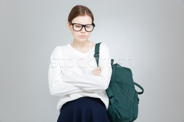 Sad depressed girl student in glasses standing with hands folded  Stock photo © deandrobot