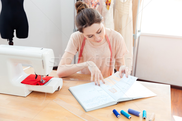 Thoughtful woman seamstress working in studio Stock photo © deandrobot