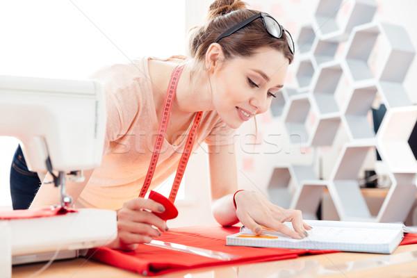 Mutlu kadın çalışmak kırmızı kumaş genç kadın Stok fotoğraf © deandrobot