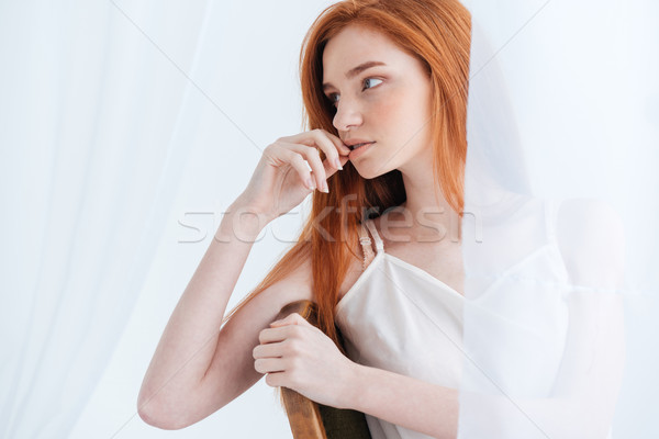 Thoughtful redhead woman looking away Stock photo © deandrobot