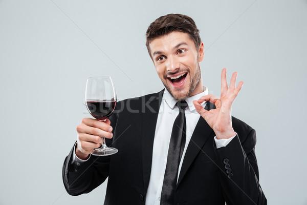 Vrolijk dronken zakenman drinken rode wijn tonen Stockfoto © deandrobot