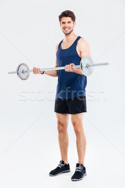 Gelukkig jonge man atleet permanente opleiding barbell Stockfoto © deandrobot