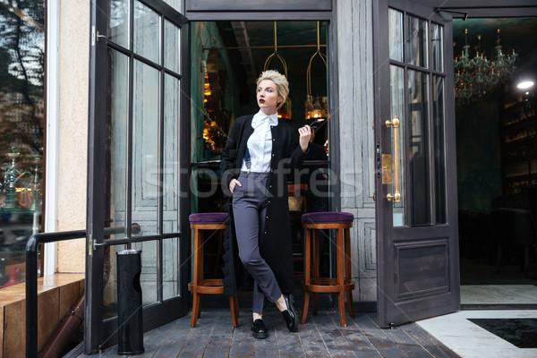 моде блоггер позируют кафе молодые Сток-фото © deandrobot