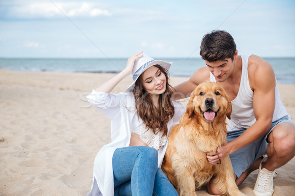 Jovem amoroso casal jogar cão beira-mar Foto stock © deandrobot