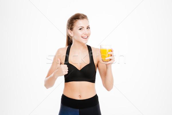 スポーツウーマン オレンジジュース ガラス ストックフォト © deandrobot