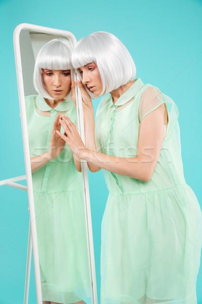 美しい 若い女性 ブロンド かつら 立って 触れる ストックフォト © deandrobot