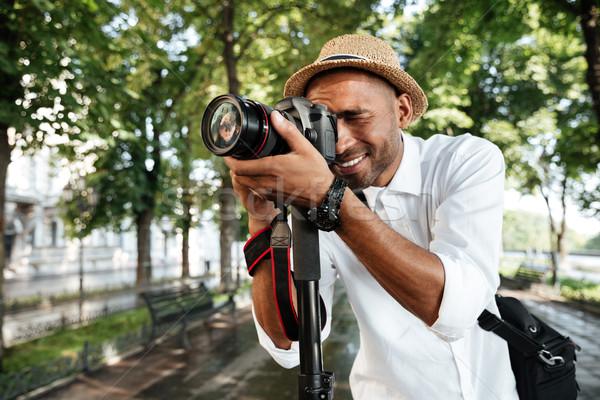 Gülen siyah adam park kamera adam mutlu Stok fotoğraf © deandrobot