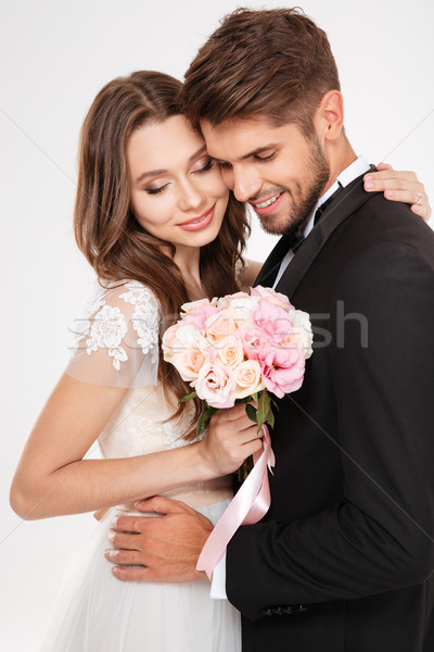 Cool couple with bouqute Stock photo © deandrobot