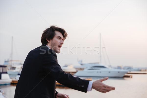 Emocjonalny człowiek garnitur portu świetle Zdjęcia stock © deandrobot